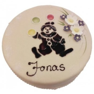 Marsipankake med skrift pyntet med blomster og en tegnet klovn som sjonglerer
